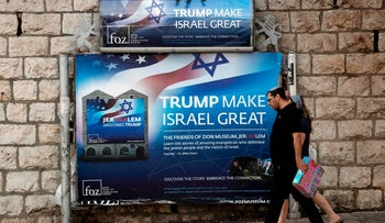 FILE Photo: Israelis walk past a poster welcoming and supporting U.S. President Donald Trump in Jerusalem, May 19, 2017.