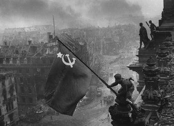"""The iconic """"Raising a flag over the Reichstag"""" photo by Yevgeny Khaldei."""