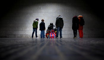 File photo: Tourists stand around the sculpture 'Mother with her Dead Son' at the Neue Wache in Berlin.