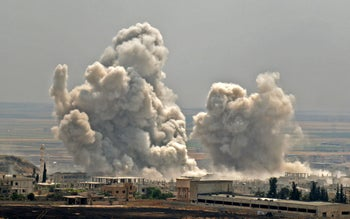 Plumes of smoke rise following reported Syrian government forces' bombardment on the town of Khan Sheikhun in the southern countryside of the jihadist-held Idlib province, June 7, 2019.
