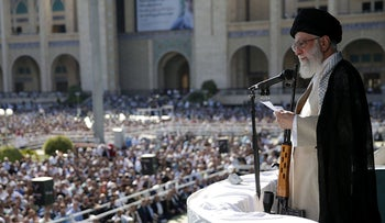Iran's supreme leader, Ayatollah Ali Khamenei, addressing worshippers with a rifle in front of him as he  delivers the Eid al-Fitr sermon in Tehran, June 5, 2019.