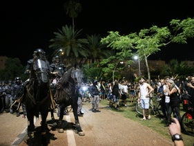 Police on horseback trying to control the crowd at Rabin Square, June 7, 2019.