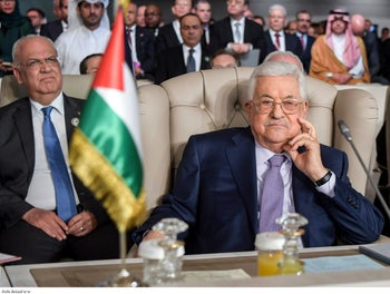 Palestinian President Mahmoud Abbas and secretary general of the Palestinian Liberation Organization Saeb Erekat attend the opening of the 30th Arab Summit in Tunis, Tunisia, March 31, 2019.