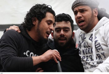 FILE Photo: Abdelbaset Sarout sings during a rally y to commemorate the beginning of the Syrian revolution, Idlib province, March 15, 2019.