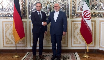 Iranian Foreign Minister Mohammad Javad Zarif shakes hands with his German counterpart Heiko Maas after their meeting in Teheran, Iran, June 10, 2019.