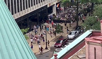 People run on a closed street to escape from what they thought was gunfire at a gay pride parade in Washington, U.S. June 8, 2019, in this still image taken from a video obtained via social media