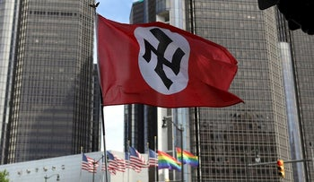 Members of the National Socialist Movement, a white nationalist group, demonstrate against the LGBTQ event Motor City Pride in Detroit, Michigan, U.S., June 8, 2019
