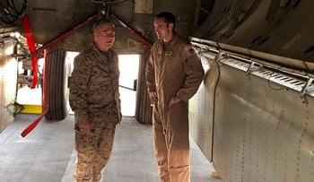 Marine Gen. Frank McKenzie, head of U.S. Central Command, confers with an Air Force officer below the bomb bay of a B-52 bomber on Friday, June 7, 2019 at al-Udeid air base in Qatar