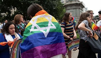 Members of the Jewish LGBTQ community wait to see if they are allowed to participate with their Star of David flags in the Dyke March in Washington, DC. June 7, 2019