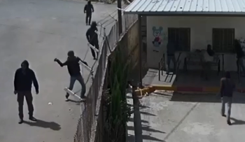 Camera footage shows masked individuals hurling stones at a Palestinian school, at the West Bank village of Jalud, June 2019.