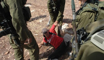 File photo: Jonathan Pollak at a protest in Bil'in, 2005.