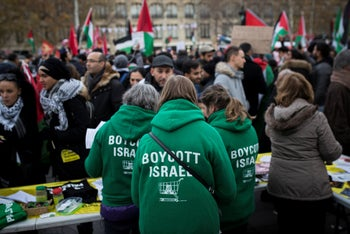 "Demonstrators wear shirts reading ""Boycott Israel"" during a protest in Paris, Dec. 9, 2017."