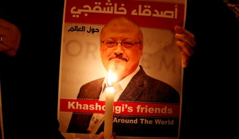 A demonstrator holds a poster with a picture of Jamal Khashoggi outside the Saudi consulate in Istanbul, Turkey, October 25, 2018.
