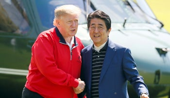Trump welcomed by Japanese Prime Minister Shinzo Abe in the south of Tokyo, May 26, 2019.