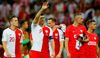 Poland's Robert Lewandowski celebrates after the match against Israel with teammates in Warsaw, Poland, June 10, 2019