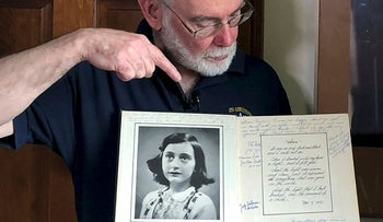 In this June 7, 2019 photo, Ryan Cooper holds a 1972 portion of a diary that he wrote when he visited Otto Frank, the father of the famed Holocaust victim and diarist Anne Frank, at his home in Yarmouth, Mass