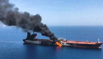 A picture obtained by AFP from Iranian News Agency ISNA on June 13, 2019 reportedly shows fire and smoke billowing from a tanker said to have been attacked in the waters of the Gulf of Oman