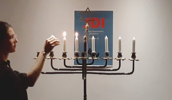 A Hanukkah event for the Jewish Democratic Initiative, December 2018.