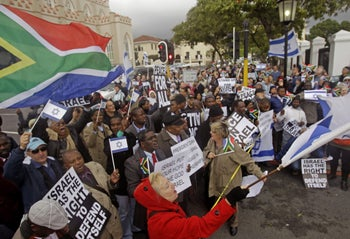 "Israel supporters protesting in Cape Town against a proposal from South African Trade Minister Rob Davies to label goods originating from Israel as ""Made in Occupied Palestinian Territory,"" June 2012."