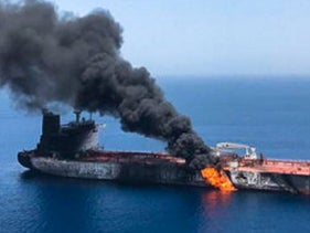 An oil tanker is seen after it was attacked at the Gulf of Oman, June 13, 2019.