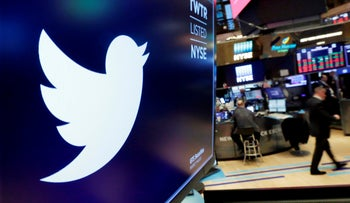 The logo for Twitter is displayed above a trading post on the floor of the New York Stock Exchange, 2018.