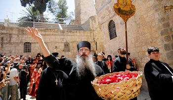 A member of the Greek Orthodox clergy during a procession on Easter Sunday at the Church of the Holy Sepulchre in Jerusalem's Old City, April 28, 2019.