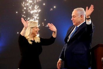 Prime Minister Benjamin Netanyahu and his wife Sara react following the announcement of exit polls in Israel's parliamentary election at the Likud headquarters in Tel Aviv, April 10, 2019.