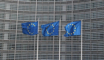 European Union flags fly outside the European Commission headquarters in Brussels, Belgium, April 10, 2019.