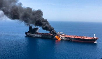 Smoke billowing from the Front Altair tanker said to have been attacked off the coast of Oman, June 13, 2019.