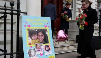 A supporter moves flowers after Richard Ratcliffe, husband of British-Iranian dual national Nazanin Zaghari-Ratcliffe, delivered a Mother's Day card and flowers to the Iranian Embassy in London, Britain March 31, 2019.
