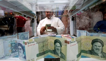 A man counts Iranian rials at a currency exchange shop, before the start of the U.S. sanctions on Tehran, in Basra, Iraq, November 3, 2018.