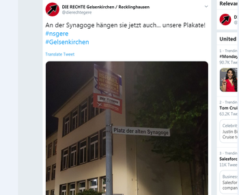 """The German neo-Nazi party Die Rechte boasts on Twitter about hanging a poster with the slogan """"Israel is our misfortune"""" on a signpost for the destroyed synagogue in the German town of Gelsenkirchen"""