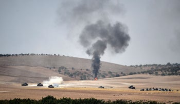 FILE PHOTO: Turkish army tanks and alleged Syrian opposition fighter trucks in Syria, west of Jarablus, on August 24, 2016