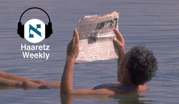 A man reading Haaretz while floating in the Dead Sea in 1980.