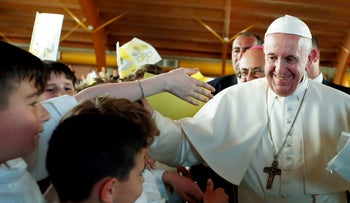 Pope Francis meets with children during his visit to the town of Camerino, Italy, June 16, 2019.