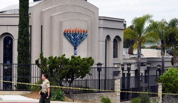 San Diego county sheriff's deputy stands in front of the Poway Chabad Synagogue in Poway, California, April 28, 2019.