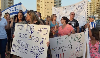 Afula residents protest the selling of homes to Arabs, June 21, 2018.