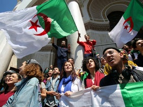 Demonstrators hold flag during anti government protests in Algiers, Algeria, April 23, 2019.
