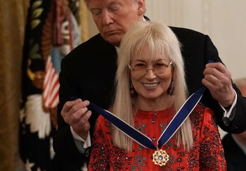 U.S. President Donald Trump presents the Presidential Medal of Freedom to physician Miriam Adelson.
