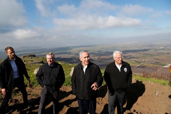 Israeli Prime Minister Benjamin Netanyahu, U.S. Republican Senator Lindsey Graham and U.S. Ambassador to Israel David Friedman visit the border between Israel and Syria on the Israeli-occupied Golan Heights. March 11, 2019