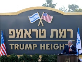 Prime Minister Benjamin Netanyahu unveils the Ramat Trump sign in the Golan Heights, June 16, 2019.