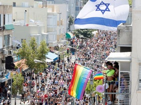Revellers take part in an annual gay pride parade in Tel Aviv, Israel June 14, 2019