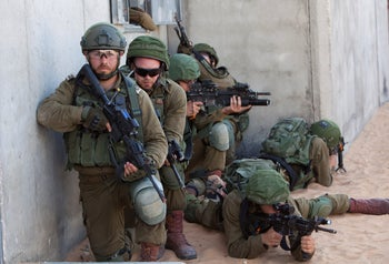 Soldiers participating in an exercise at the Israel Defense Forces Tze'elim base, June 2019.