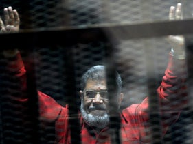 Morsi inside a defendants cage in a makeshift courtroom at the national police academy, in an eastern suburb of Cairo, Egypt, June 21, 2015
