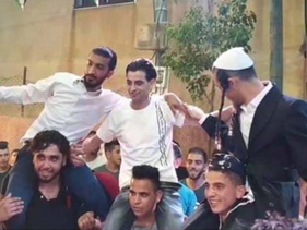 A screenshot of the Jewish settlers dancing at the Palestinian wedding