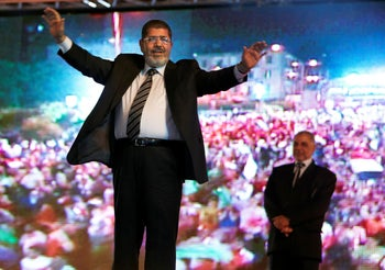 then-presidential candidate Morsi holds a rally in Cairo, Egypt, May 20, 2012.