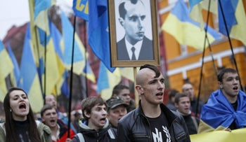 Activists of the Svoboda Ukrainian nationalist party taking part in a rally marking the 71st anniversary of the Ukrainian Insurgent Army, Kiev, October 14, 2013.