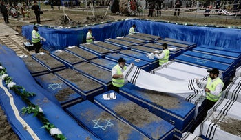 File Photo: Volunteers perform the final rites before burying the remains of Holocaust victims at a cemetery just outside Brest, Belarus, Wednesday, May 22, 2019