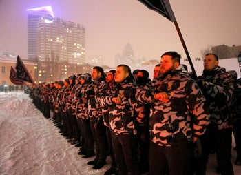 Volunteers of the right-wing paramilitary Azov Civil Corps swearing an oath of allegiance in central Kiev, Ukraine, January 2018.