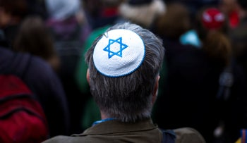 A man wearing a Jewish skullcap at a demonstration against an anti-Semitic attack in Berlin, April 25, 2018.
